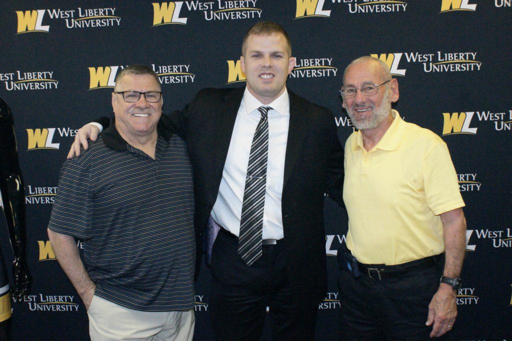 Former wrestling coach legends Rick Price and Vince Monseau welcome new Head Coach Danny Irwin (center).